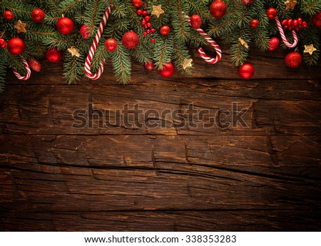Christmas fir tree with decoration on a wooden board. Free space for text - stock photo