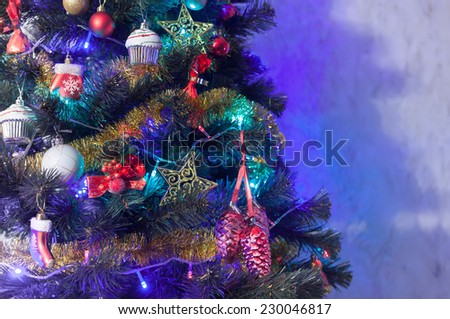 Christmas fir tree with red and gold decoration,shiny blue and green lights  - horizontal background - stock photo