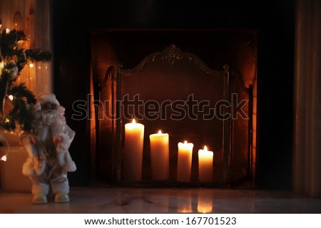 Christmas fireplace with burning candles  - stock photo