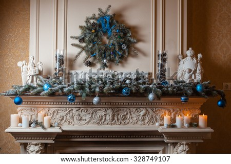 Christmas fireplace with decorations of fir branches and Christmas toys - stock photo