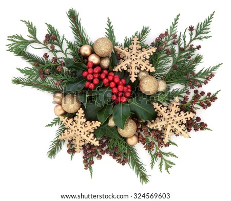 Christmas flora with gold bauble and star decorations with holly, ivy and winter greenery over white background. - stock photo