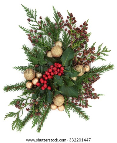 Christmas flora with gold bauble decorations, holly, ivy and winter greenery over white background. - stock photo