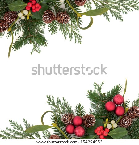 Christmas floral background border with red baubles, holly, ivy, mistletoe, pine cones and winter greenery over white background. - stock photo