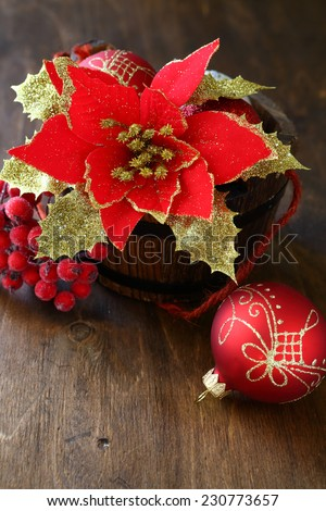 Christmas flower and balls on plywood, merry xmas - stock photo