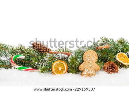 Christmas food and decor over snow fir tree. Isolated on white background with copy space - stock photo