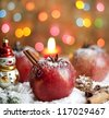 Christmas food apples on snow closeup and blurred background - stock photo