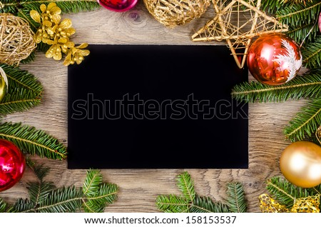 Christmas frame for congratulations and black paper - stock photo