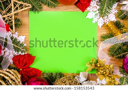 Christmas frame for congratulations and green paper - stock photo