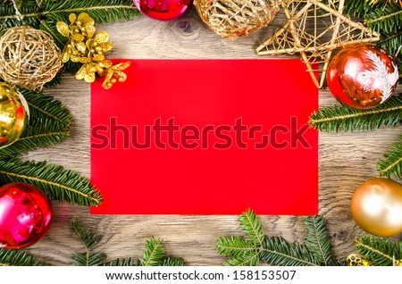 Christmas frame for congratulations and red paper - stock photo