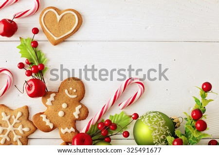 Christmas frame for greeting card with decorative christmas gingerbread cookies and ornaments