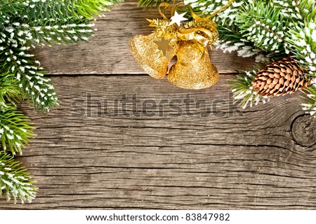 Christmas frame from branch and decorations on old wooden background - stock photo