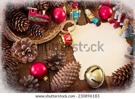 Christmas frame with Christmas decorations, pine cones and basket. Toning. Vintage postcards. Imitation of Vintage - stock photo