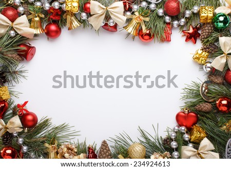 Christmas frame with Christmas ornaments and decorations - stock photo