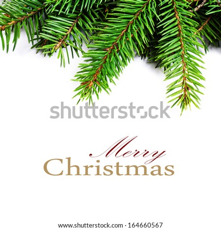 Christmas Frame with Natural Fir Tree Branch  isolated on white background. Evergreen Border close up  (with easy removable sample text) - stock photo