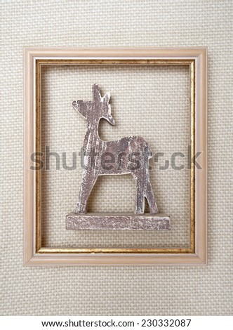 Christmas framed picture with reindeer on wool plaid  background   - stock photo