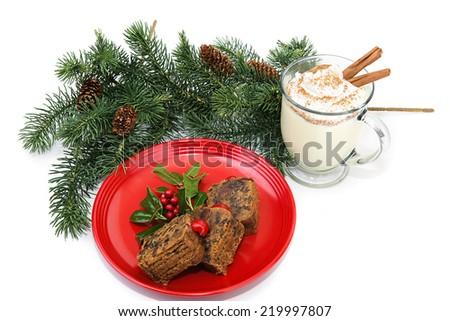 Christmas fruitcake and eggnog on white background.   - stock photo