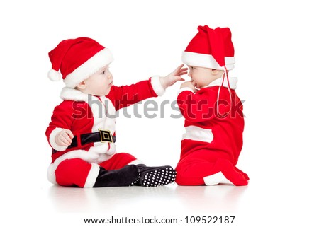 Christmas funny small kids in Santa Claus clothes isolated on white background - stock photo