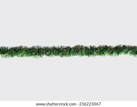 Christmas Garland isolated on Grey Background. Top View of Xmas Decoration Close-Up with Text Space - stock photo