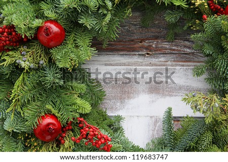 Christmas garland on a rustic wooden background. - stock photo