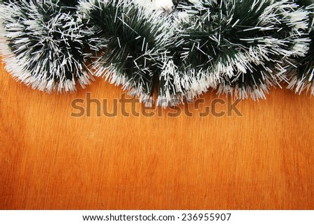 Christmas Garland over wooden background - stock photo