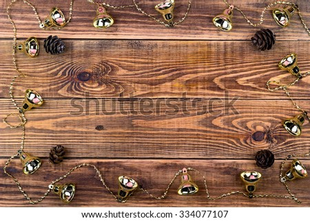 Christmas garlands on a brown wooden background with a place for your text - stock photo