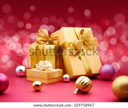 Christmas gift and decoration on red background - stock photo