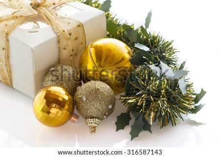 Christmas gift box, balls and fir tree. Isolated on white background with copy space - stock photo
