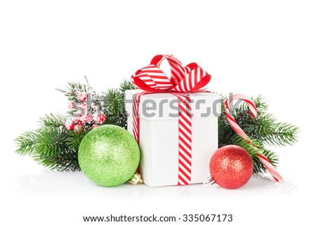 Christmas gift box, baubles and candy cane. Isolated on white background - stock photo