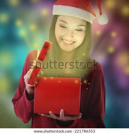 Christmas gift box opened from Santa women  - stock photo