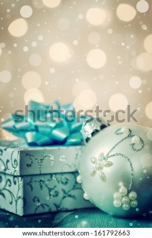 Christmas gift box with christmas ball - stock photo