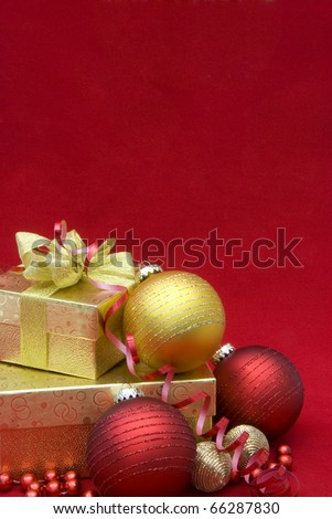 Christmas gift box with christmas balls on red background - stock photo
