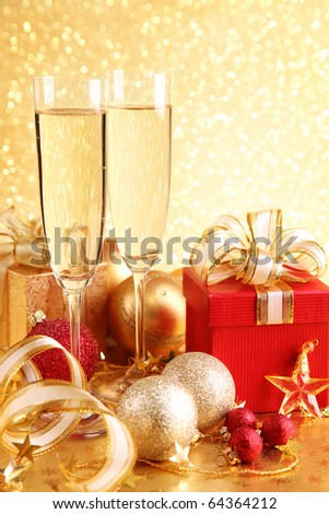 Christmas gift box with glasses of champagne - stock photo