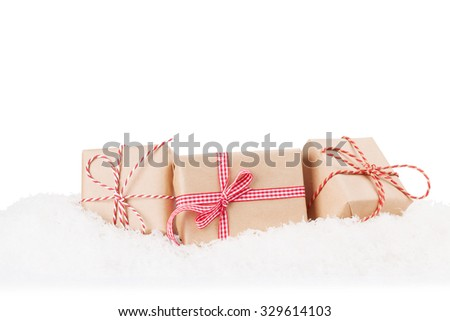 Christmas gift boxes in snow. Isolated on white background - stock photo