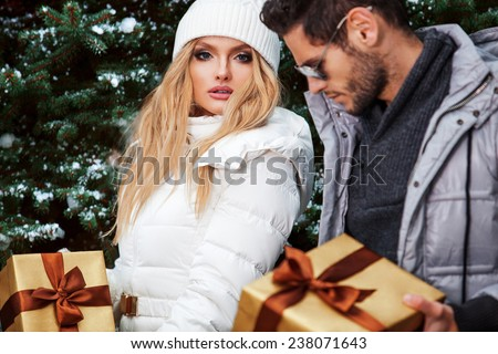 Christmas Gift. Happy Couple with Christmas and New Year Gift  - stock photo