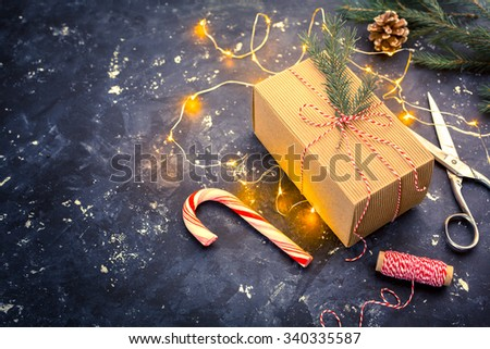 Christmas Gift on a dark background. Shallow DOF - stock photo