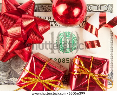Christmas gift. One hundred bill with ornaments - stock photo