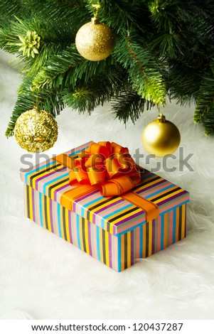 Christmas gift under the tree - stock photo