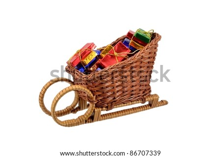 Christmas gift wrapped chocolates on a sleigh - stock photo