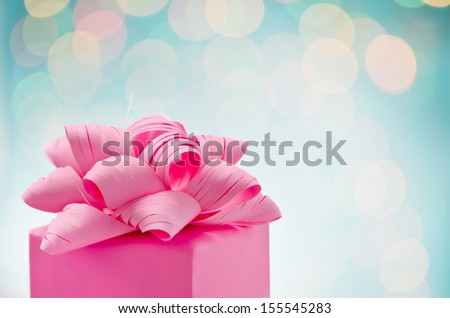 Christmas gift wrapped with bow, close-up - stock photo