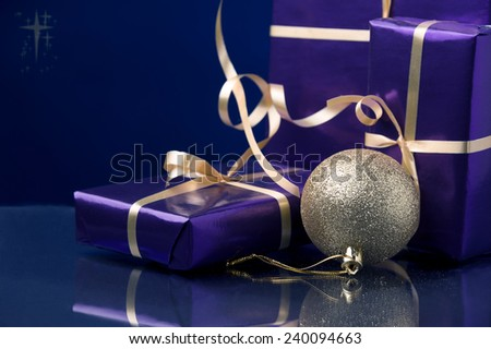 Christmas gifts and gold decoration and Christmas stars  - stock photo