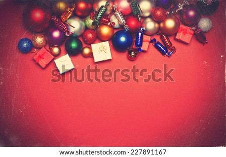 Christmas gifts on red background. - stock photo
