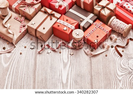 Christmas Gifts with ribbons on light wood background - stock photo