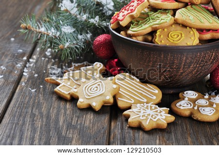 Christmas Ginger and Honey cookies on wooden background. Star, fir tree, heart, bear shape. - stock photo