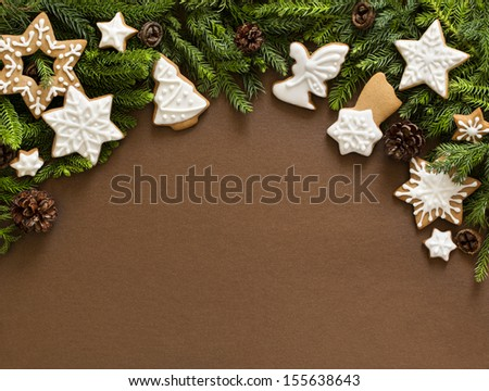 Christmas ginger stars, angels and fir tree decoration. Brown background. - stock photo