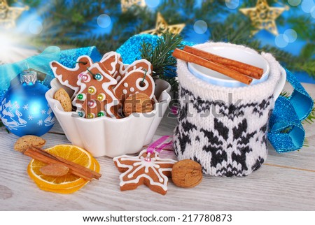 christmas gingerbread cookies and milk in cup with knitted cover waiting for santa claus - stock photo