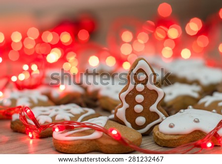 Christmas Gingerbread Cookies homemade on wooden table with decoration holidays light . - stock photo