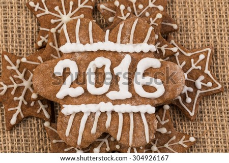 Christmas Gingerbread Cookies homemade with decoration on Sackcloth - stock photo