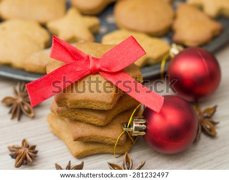 Christmas Gingerbread Cookies homemade with red bow . - stock photo