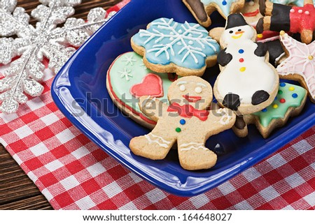 Christmas gingerbread cookies on a plate on the table - stock photo