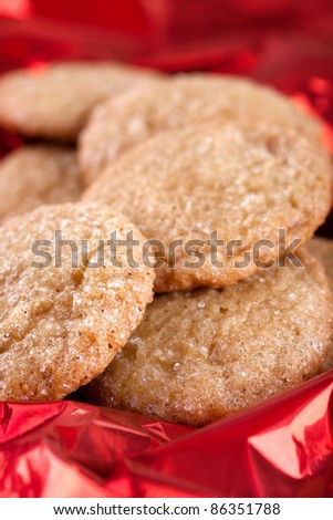 Christmas gingerbread cookies on red background - stock photo